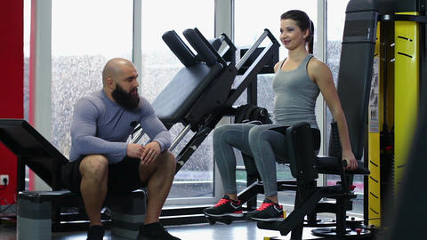 Couple of active young people talking during workout in gym, healthy lifestyle Footage