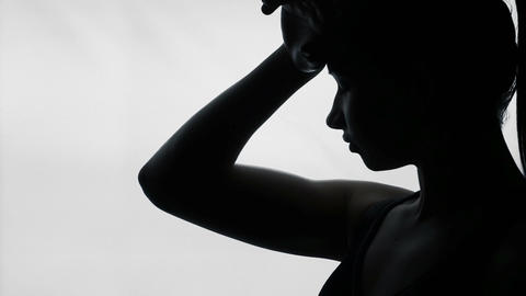 Silhouette of woman feeling bad during period, young female having headache Footage