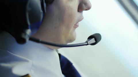Attentive pilot navigating airplane, transmitting information to dispatcher Live Action