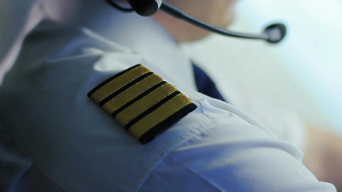 Successful air crew commander dressed in uniform with epaulets operating plane Footage