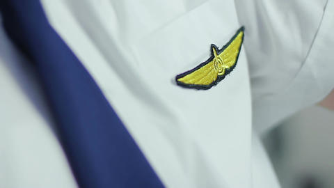 Pilot insignia on uniform, closeup. Exciting profession, well paid job Live Action