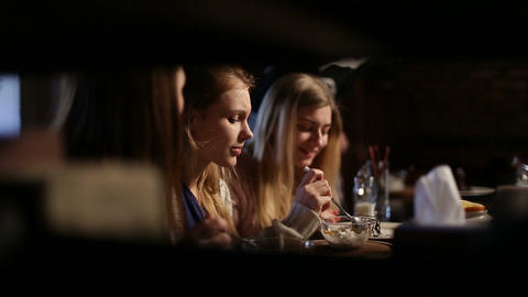 Group of girls meeting for lunch at restaurant Footage