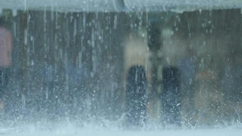 Macro Rain Drops Fall against Landing Gear Footage