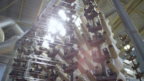 Operating Spinning Shop with Turning White Thread Bobbins Footage