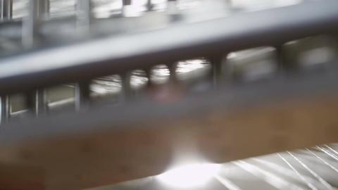 Macro White Threads from Spinning Machine at Sunlight Beam Footage