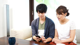 Watch smartphone with couple (couple) Footage