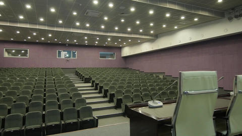Panorama from Leather Chair to Microphone Table in Cinema Hall Footage
