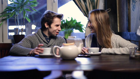 Loving couple on a date drinking tea at restaurant Footage