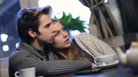 Loving young couple hugging while resting in cafe Footage