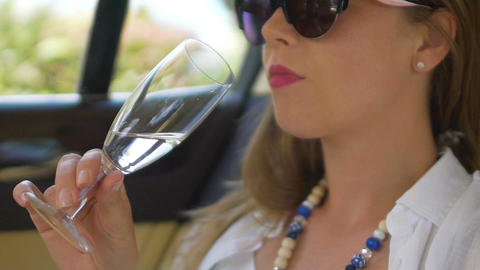 Happy woman enjoying comfort in limo, drinking refreshing wine, dolce vita Live Action