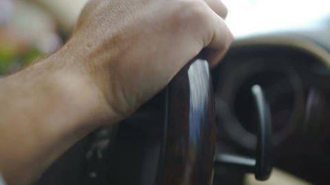 Hands of professional chauffeur turning steering wheel, businessman driving car Footage