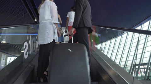 Business trip, partners arriving at conference, moving on escalator in airport Footage