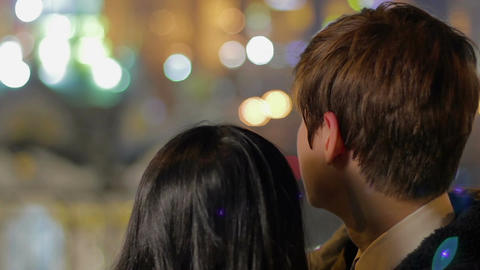Couple in love enjoying view on beautiful night city, romance, togetherness Footage