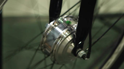 Shiny steel bike wheel rotating at repair shop, active lifestyle, extreme sport Footage