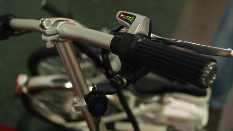 Female turning key to start environmentally safe electric bicycle, eco transport Archivo