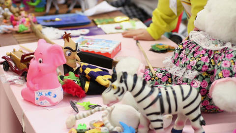 Many toys lying on table, children playing games at kindergarten or orphan home Footage