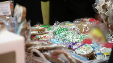 People buying delicious ginger cookies, traditional baked Christmas souvenirs Footage