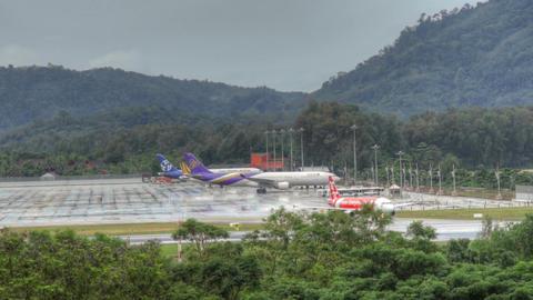 Phuket airport traffic at rain Footage