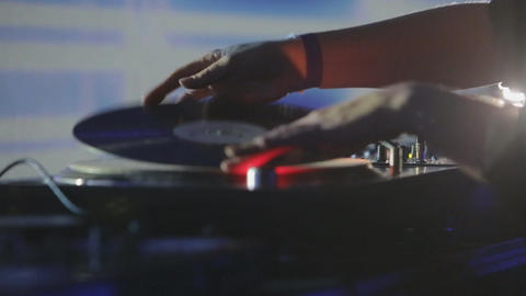 Female DJ in club plays music on Vinyl Footage