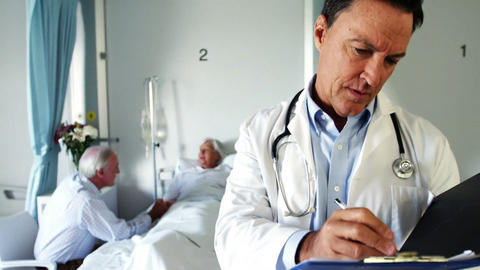Male doctor checking medical reports Footage