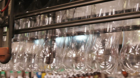 Rows of empty water bottles at bottling plant Footage