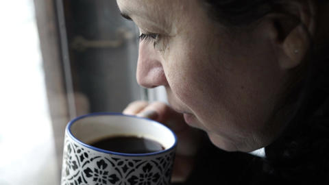 Woman at Window Drinking Coffee Handheld Live Action