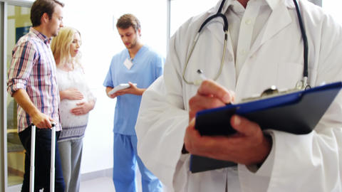 Portrait of male doctor holding a medical report Footage