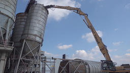 Bulldozer Taking Down Old Silo Tower Footage