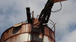 Demolition crane destroy rusty metal construction Footage