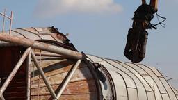 Demolition crane with pulverizer grinder side view Footage