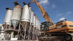Dismantling old silo tanks with demolition crane Footage