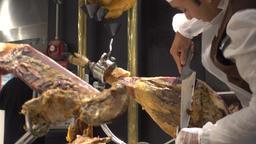 Butcher Cutting smoked pork loin Footage
