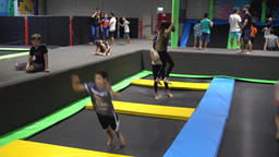 Kids jumping on trampolines at an indoor park Footage