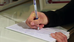 Close up on hands filling up questionnaire Footage