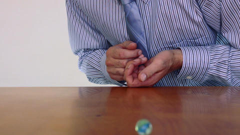 Businessman Shoots Marble Competition Stock Video Footage