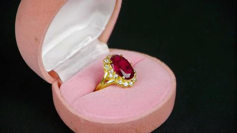 Rotation of ruby diamond ring Stock Video Footage