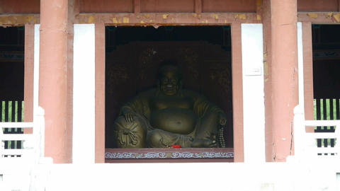 Saw statue of Bodhisattva Maitreya,Enter yard from door... Stock Video Footage