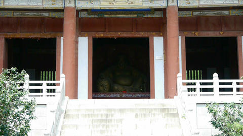 Saw statue of Bodhisattva Maitreya,Enter yard from door of Chinese ancient build Footage