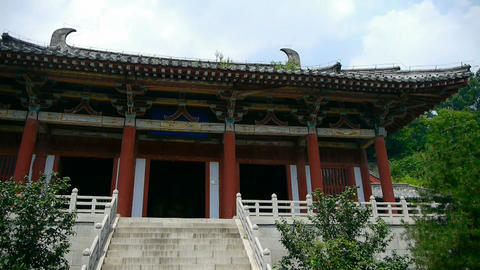 China ancient temple architecture in forest,blue sky... Stock Video Footage