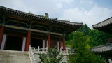 China ancient temple architecture in forest,blue sky & white clouds between  Footage