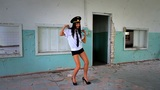 Beautiful girl posing for the camera in clothing cadet. 11 Footage