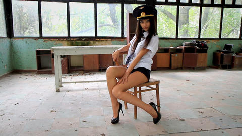 Beautiful girl posing for the camera in clothing cadet. 7 Stock Video Footage