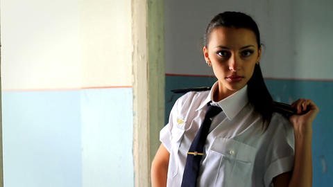 Beautiful girl posing for the camera in clothing cadet. 1 Stock Video Footage