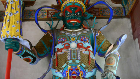 Chinese immortals Buddhist Vajra sculpture holding... Stock Video Footage