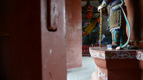 Chinese immortals Buddhist Vajra sculpture in carved beams painted buildings,anc Footage