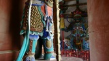 Chinese immortals Buddhist samurai Vajra sculpture in carved beams painted build Footage
