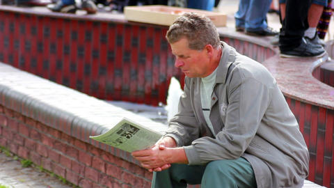 Man reading a newspaper 1 Stock Video Footage