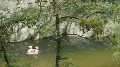 People swimming in lake,father teach children to swim Stock Video Footage