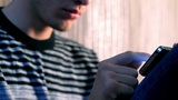 young adult man using touchscreen phone Footage