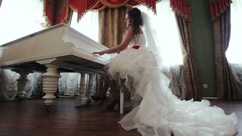 Bride playing the piano indoors Stock Video Footage